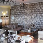 One end of sitting room with marvelous wallpaper