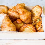 Pastries, freshly baked each day. Croissant, pain au chocolat, fruit danish, palmier and more