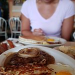 1/2 lb beef patty with gravy, grilled onions and sunny side up eggs with hash browns