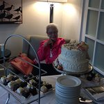 My mother, Teresa, on her 90th birthday. She was in tears over the beautiful cake.