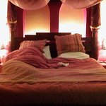 4-poster bed in Moroccan room. (Bed not made as my husband is sound asleep in it!)