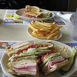 The Special Club Sandwich, French Fries and Reuben Sandwich
