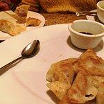 potsitckers with a shot of the won-ton soup