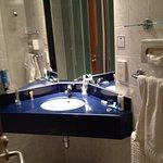 Sink & mirror utilises good space in a large bathroom