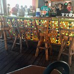backlit bar and wood stools
