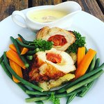 Delicious stuffed chicken breast, served with fresh vegetables