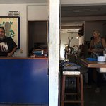 """Owner Wenceslao and his partner preparing coffee and food on """"either side of the wall"""" !"""