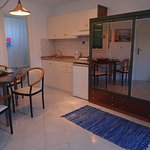 All rooms have a kitchenette and a small dining area, in addition to sleeping areas and patios.