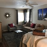Our suite has a fireplace, a comfortable living area and a queen pull out couch.