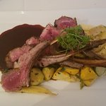 Moroccan spiced Australian rack of lamb w/creamy polenta, baby vegetables and red wine reduction