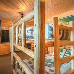 Oversized Custom log bunk bed. Features a queen bed on bottom and full size on top