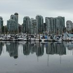 The amazing reflection of the west Vancouver skyline in the still water of the marina