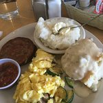 Biscuit, gravy, grits, sausage and eggs with veg