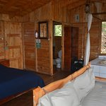Attractively wood paneled cabin with jacuzzi.