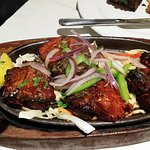 lamb chops on a sizzling hot iron platter - wow!