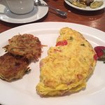 Western omelet with potato pancakes on the side.