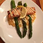 Salmon over risotto and asparagus