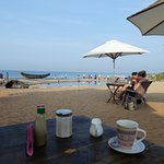 Breakfast in Varkala. In the distance, fisherman haul in their nets and ask for your help.