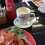 Pancakes with bacon and maple syrup and a chai latte