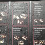 Nazimi -Street level copy of menu, rain covered.