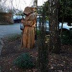 Hooded Monk wooden statue in garden