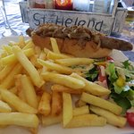 Hotdog and loads of chips and salad