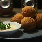 Arancini Negro (Fried mediterranean rice ball, bread cumbered with a soft cheesy heart)
