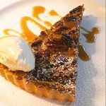 Homemade pecan toffee tart with clotted cream.