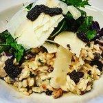 Wild mushroom & black truffle risotto, Dorset mixed leaves & parmesan shavings.