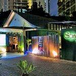 Songket Restaurant's exterior at night.