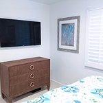 Villa Lanai Bedroom Features a Large Screen TV