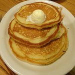 Delicious, hot pancakes slathered in butter !