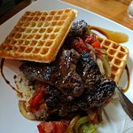 waffles with steak and grilled veggies with balsamic sauce