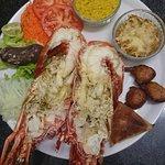 Venez réservée votre table pour dégusté le menu langouste ou un bon poisson grillé ou en court b