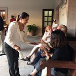 Our Armonia Spa Manager Pilar Gonzales serving snacks to our  guests on our Welcome Cocktail.