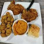 Pork chops, fried okra, sweet potato casserole and biscuit.