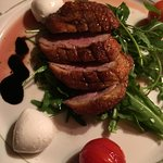 Roasted Barberie breast of duct on rocket salad