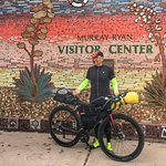 A bicyclist stops by the Silver City Visitor Center on his way to Florida from San Diego.