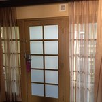 The front door of our suite, note there are curtains on both sides that can be drawn for privacy