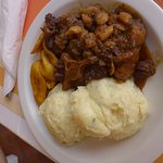 Oxtail stew with mashed potatoes and fried plantain