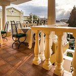 Shared balcony overlooking the garden & swimming pool
