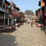 Main street of Bandipur, Old Inn on left, Himalayas behind