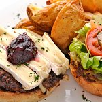 They offer pizzas, pastas and salads, a large selection of starters and AMAZING burgers.