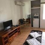 Motel room - shower/toilet  -tv ( with 4 movie channels ) -fridge  -microwave  -kettle and toast