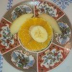 Sliced orange, banana and apple.
