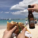 Two marlin fish sandwiches with cheese and a Banks beer.