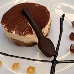 Tiramisu dessert with home made chocolate spoon and jelly garnish