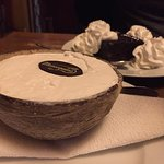 Coconut ice cream served in a shell (brownie in the back)