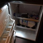 Former minibar, now employed as cramped and inefficient fridge.