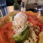 Taco Salad 15 Beans, cheese, tomatoes, sour cream and avocado in a flour tortilla basket.